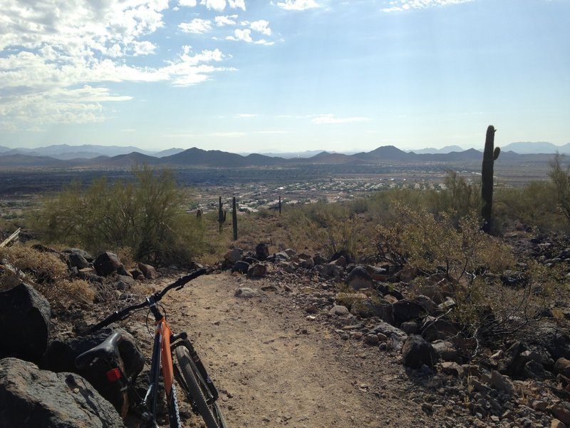 Getting ready to head downhill. The mountain in the distance are a part of the Sonoran Figure 8