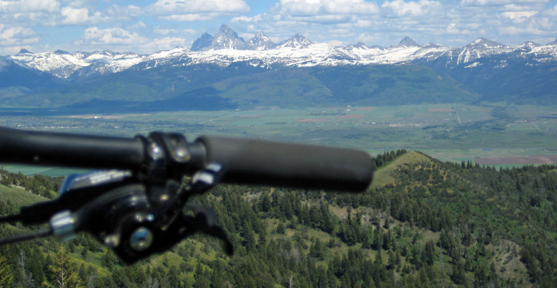 View from the top looking at the Teton Range.  Trail will hit the ridge that is on the right off the handlebar.