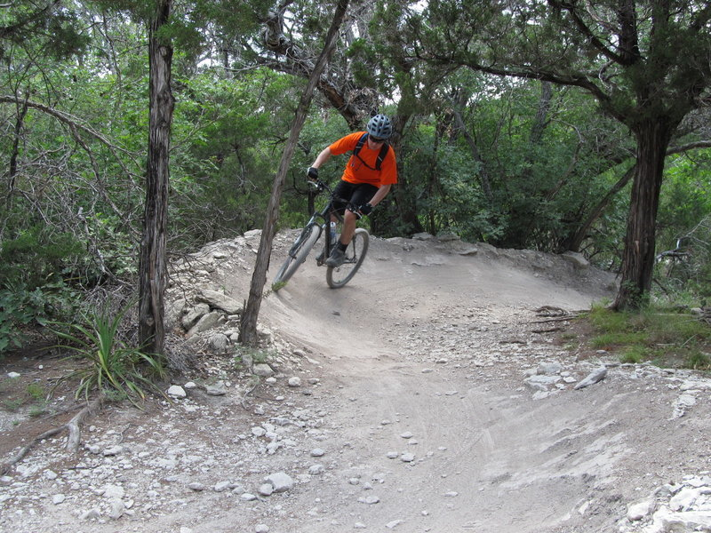 Taylor hitting the berms along the Tangle of Trails Loop