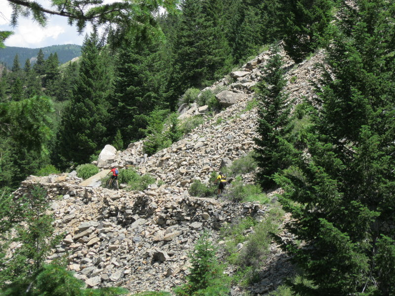 """The large slab in the picture pinches the trail to about 18"""" so you may want to walk your bike at this point."""