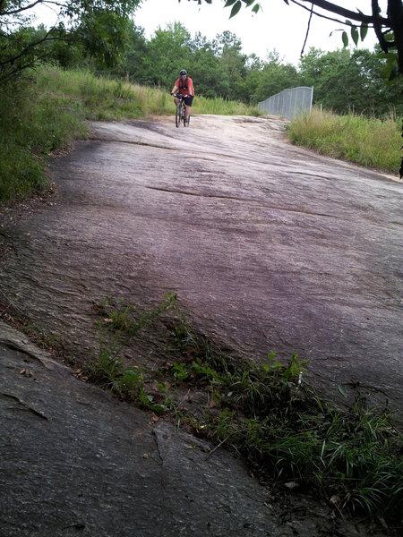 Rider descending Rock Face