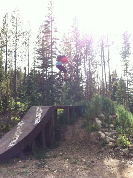 A big wood-to-dirt jump on The Bouldevard at the intersection with Banana Peel, Bear Arms and Space Ape.