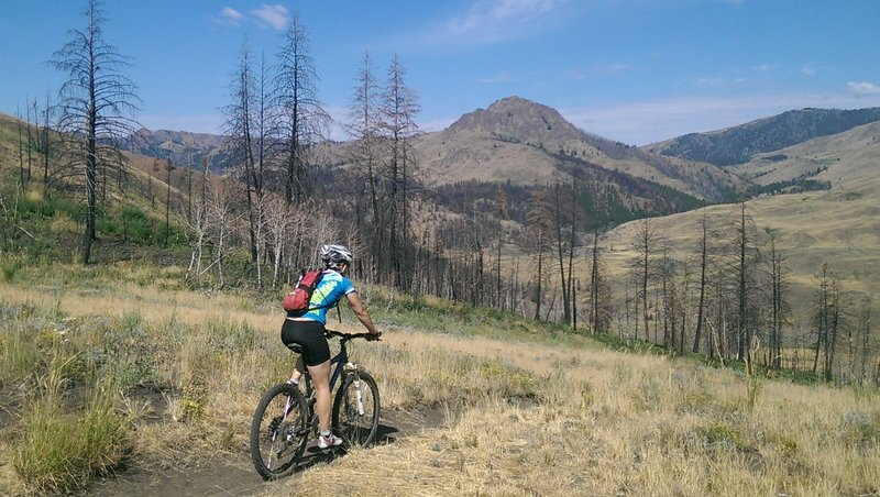 Heading down from the saddle with views of Mahoney Butte