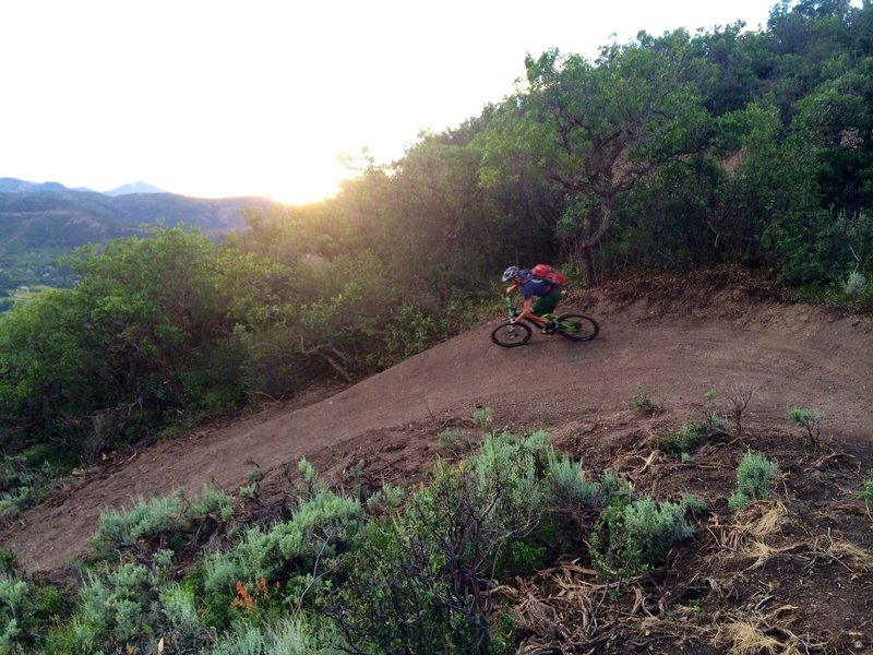 Sunset and swooping berm on the Deadline Trail.