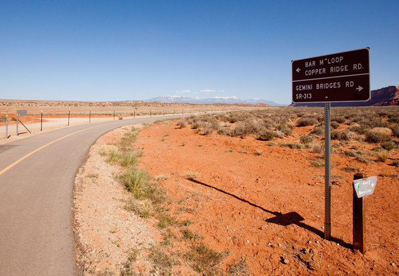 The Moab Canyon Bike Path connects Gemini Bridges and Bar M trails with Arches National Park