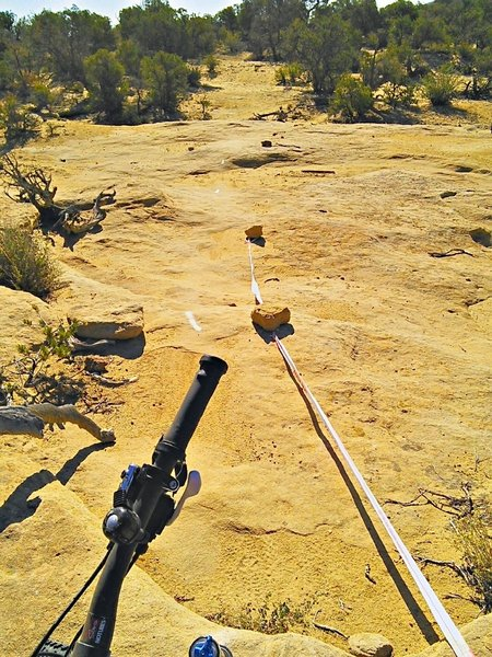 Moab-style paint arrows guide the rider across slickrock areas