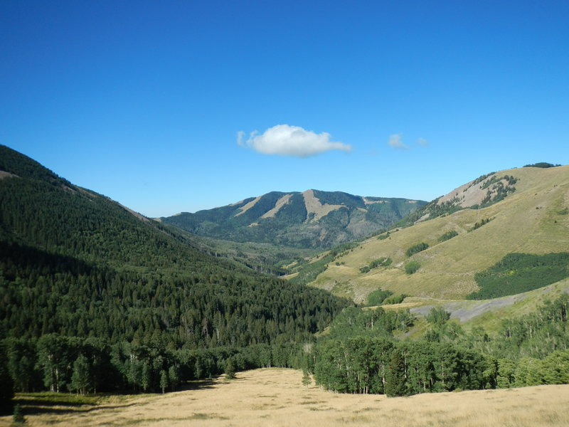 The descent on North Creek Road affords views of a spectacular alpine valley.