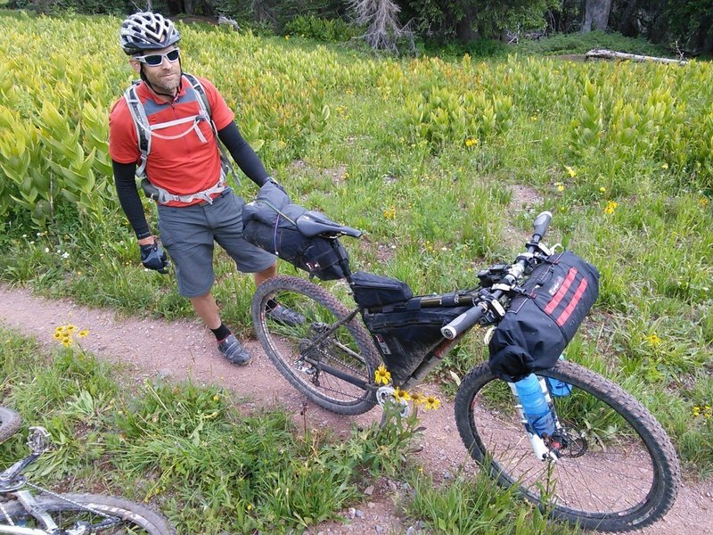 Well-equipped through-rider, a couple of weeks out of Denver