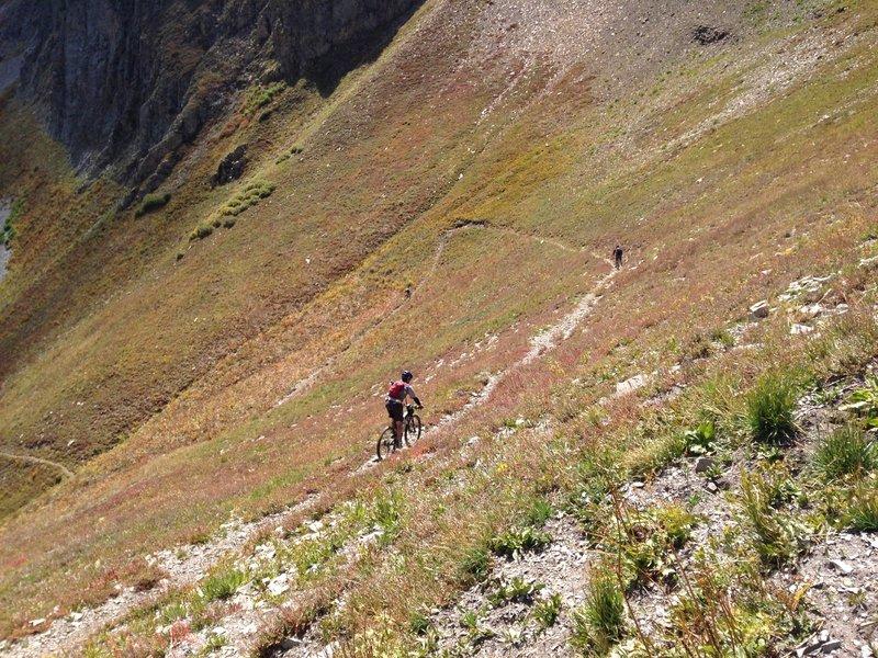 Riders descending from Sharkstooth Pass toward Bear Creek Drainage.