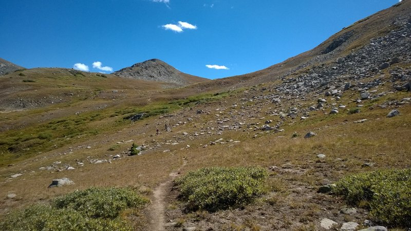 Descending some high alpine singletrack, can you spot the riders?