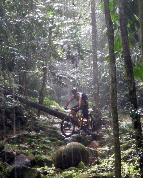 Riding through a down pour on A Sungai Runs Through It, Bukit Kiara, Malaysia