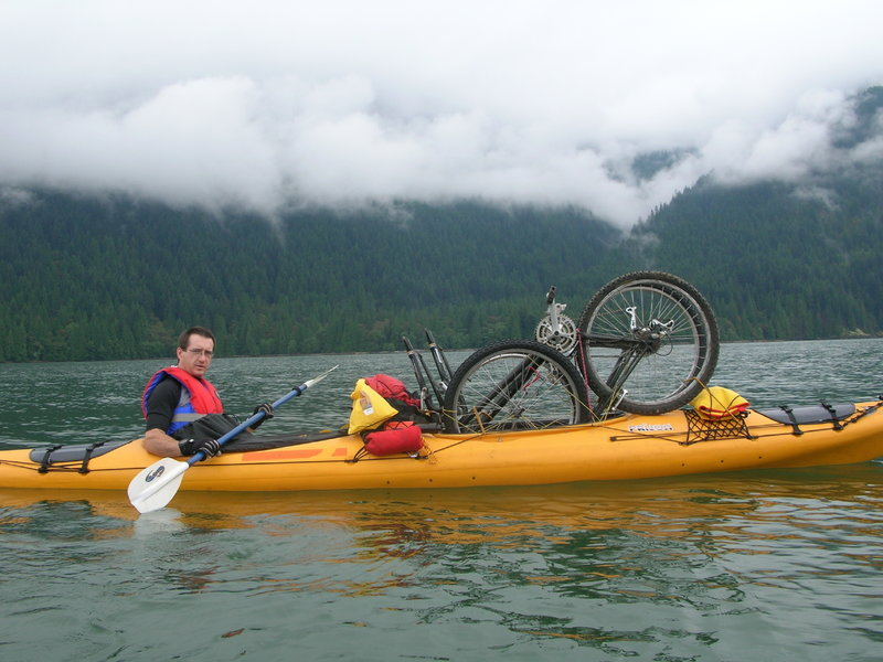A very wet trail!  Transporting the bikes up Pitt Lake for a ride to the hotsprings.