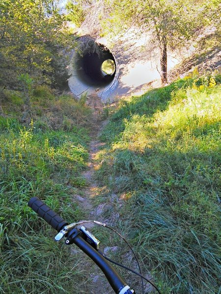 """The culvert tunnel under """"South 14"""" is well-lit and easily rideable but does include a large rock part way through"""