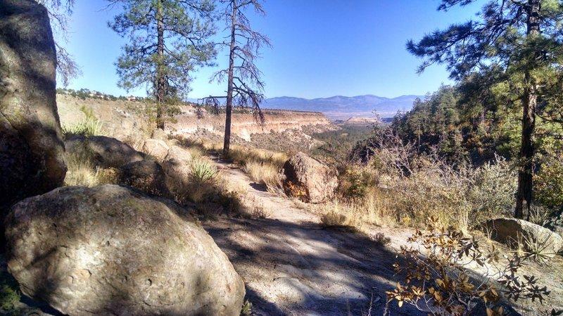 View down Pueblo Canyon, across the Rio Grande Valley to the Sangre de Cristo Mountains.