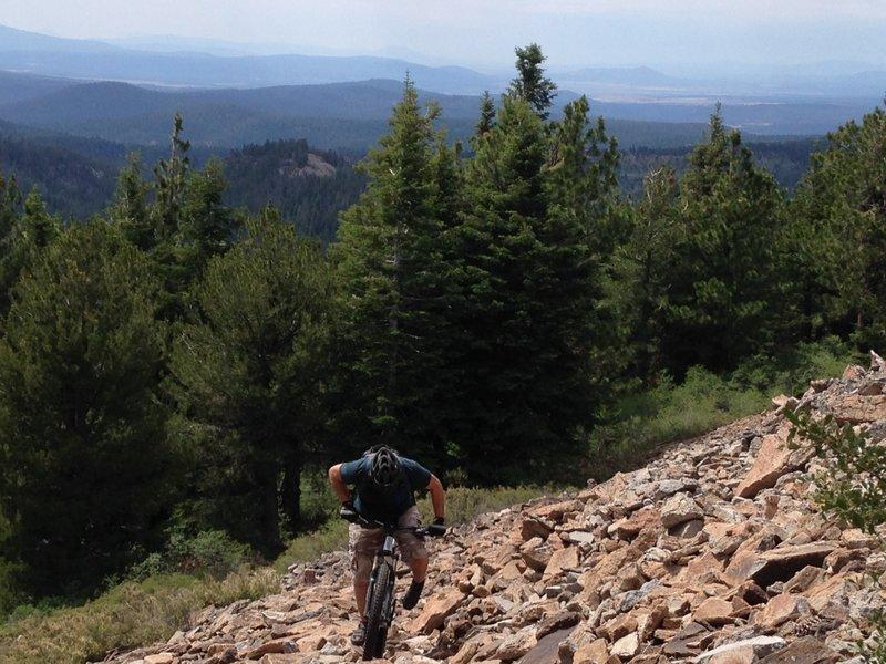 Traversing a rockslide on the Cougar Peak ascent.