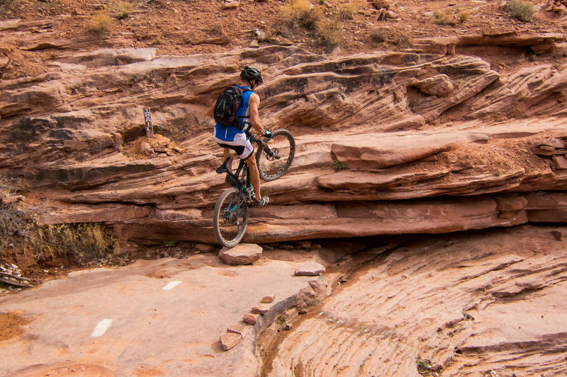 Tricky ledge step-up in the basin of the creek wash.