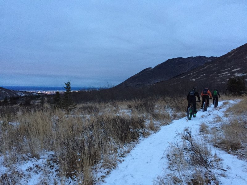 Heading down Middle Fork Trail with Anchorage lights in the distance