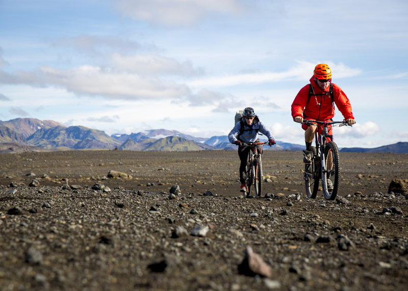 Crossing through a large valley across volcanic soils on the Laugavegur Route.