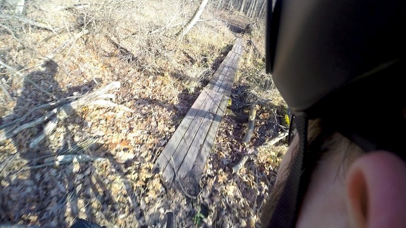 """A """"Tire Bridge"""" over one of the swampy sections."""