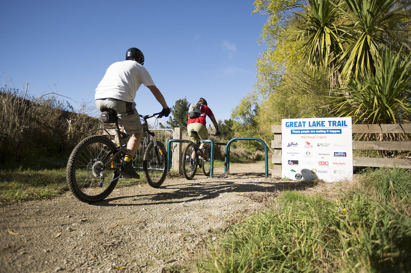 Passing through the squeeze gate at the start of the Orakau mountain bike trail