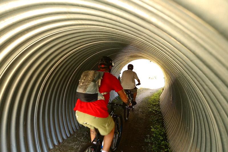 Passing through the tunnel on the Orakau mountain bike trail