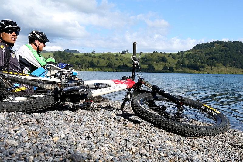 Taking a break after finishing the W2K mountain bike trail at Whakaipo Bay