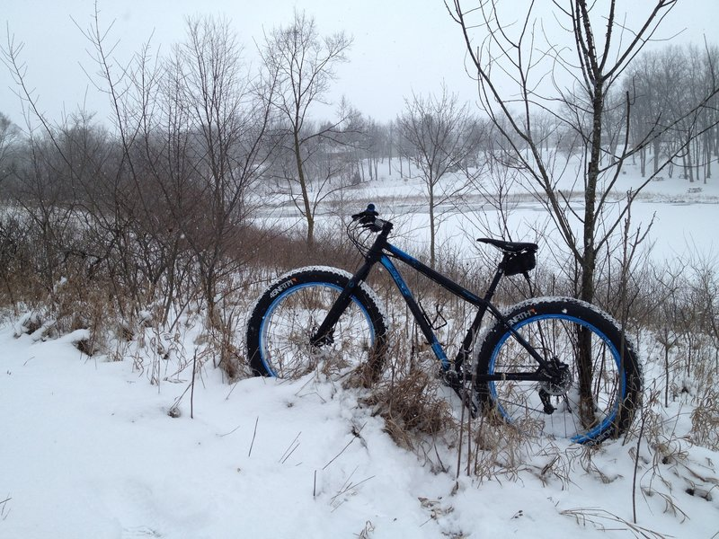 Climbing the bluff overlooking the park pond.  Wintertime riding at its best!