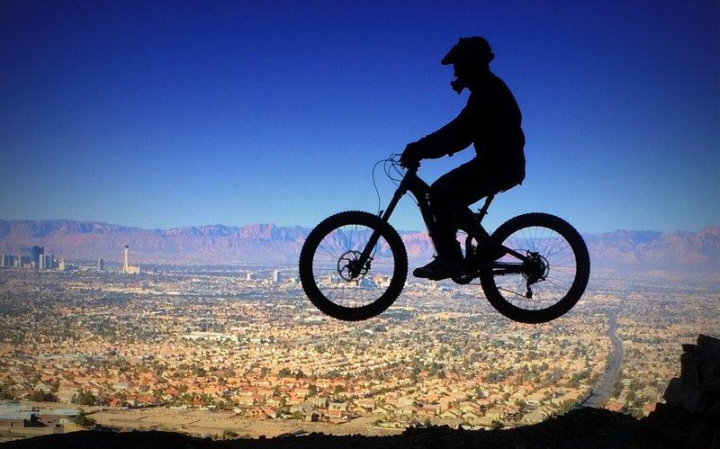 Gap jump #4 on Frenchman's Freeride overlooking Las Vegas valley