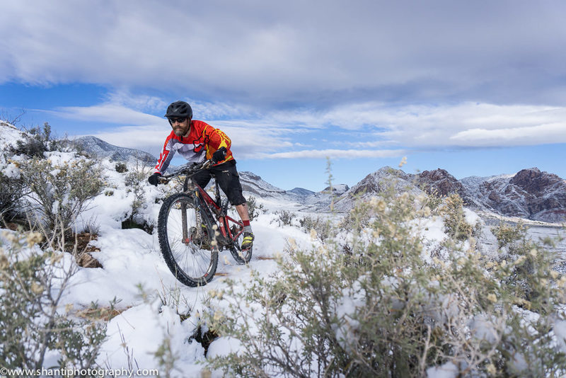 Negotiating a slick corner on Techno after a rare snow in Cottonwood