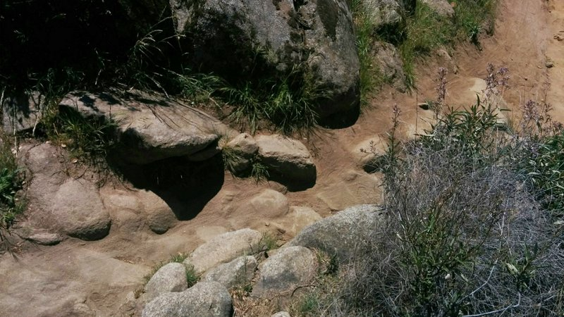 Technical area on the Granite Bay Trail featuring large rocks and loose dirt.