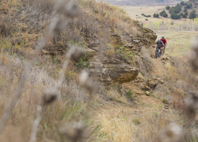Climbing a scenic section of the Hell Creek Loop.