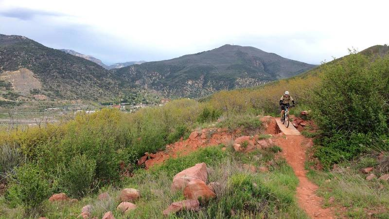 Rider heading northwest on the Defiance Trail.  Lookout Mountain & the Scout Trail are in the distance. Photo credit: Two Rivers Trails.