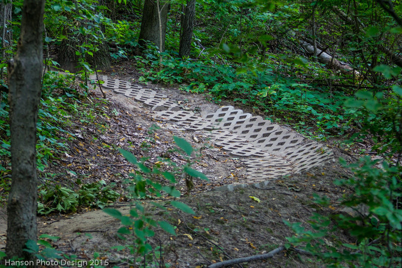Turfstone pavers armoring a steeper section with berm of the North Loop decent trail.