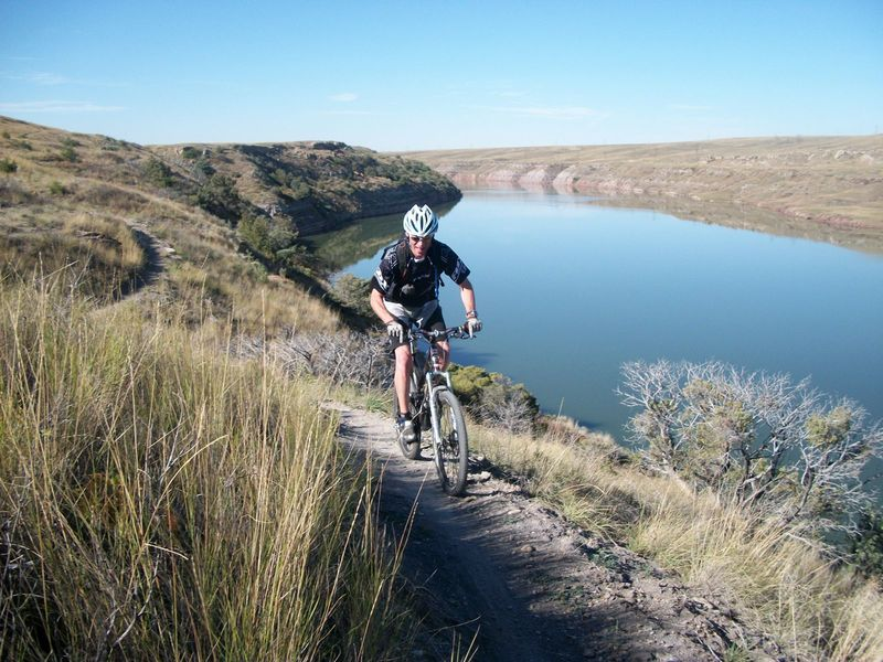 Shredding singletrack along Cochrane Reservoir.