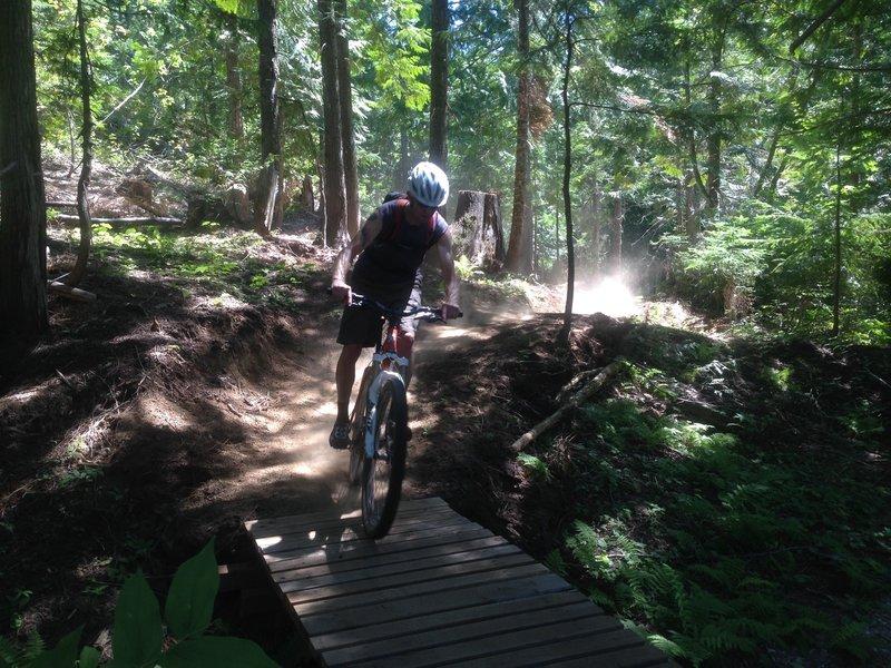 Riding over a bridge on Lower Basin XC