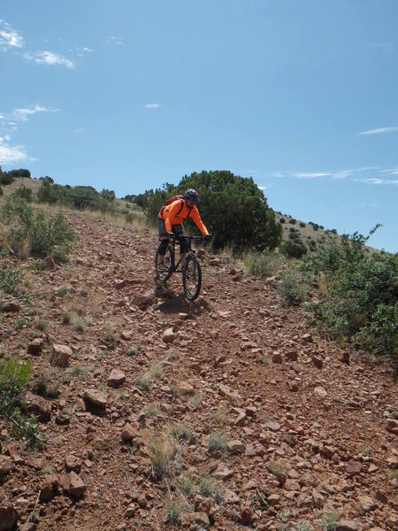 The descent from the summit is fun, fast and loose. Watch for the sharp transition at the bottom as the trail is washed out.