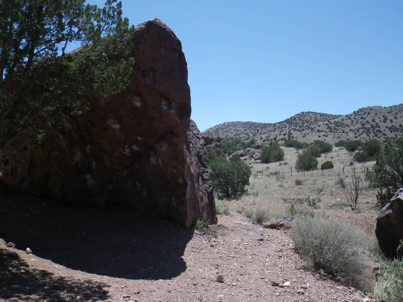 Unbeatable boulder - Lots of great lines for climbers! Trail visible on the right.