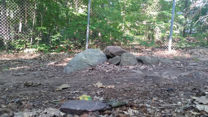 Rocks bump in the middle of the trail. View from the side of the trail.