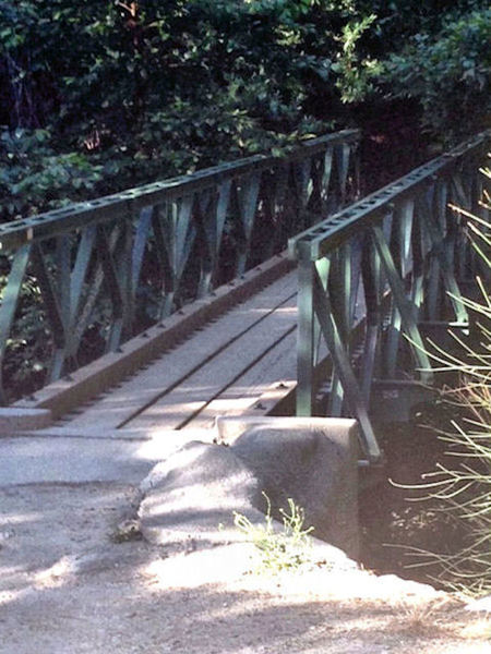 Foot bridge at Robert's Camp.  Cross the bridge or ride through the creek and start the climb up the paved fireroad to the Chantry Flat parking lot.