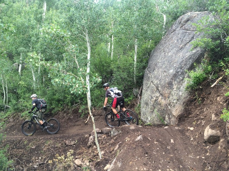 Riding by the big boulder along the Hummingbird Trail.