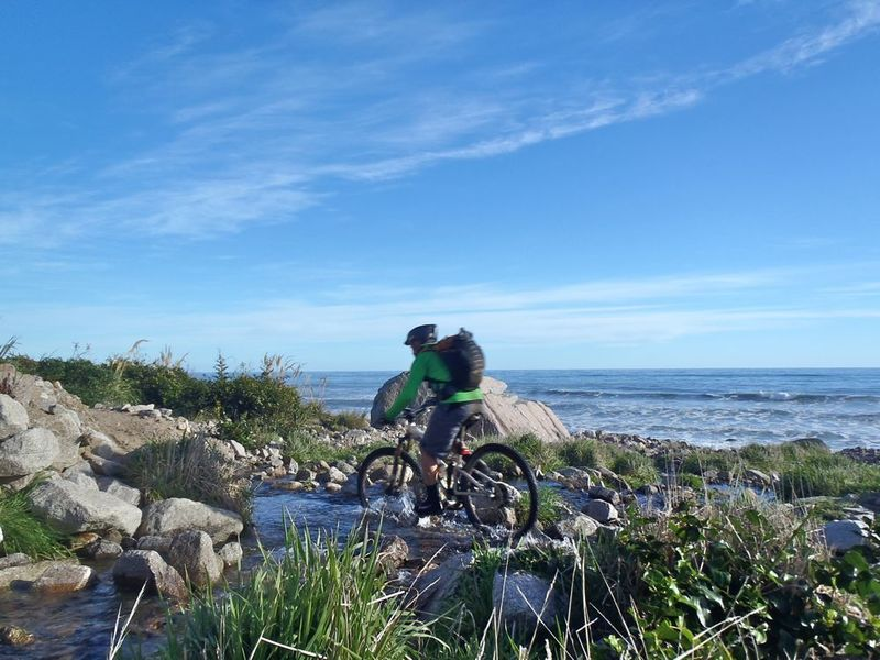 Riding a creek on the coastal section of track
