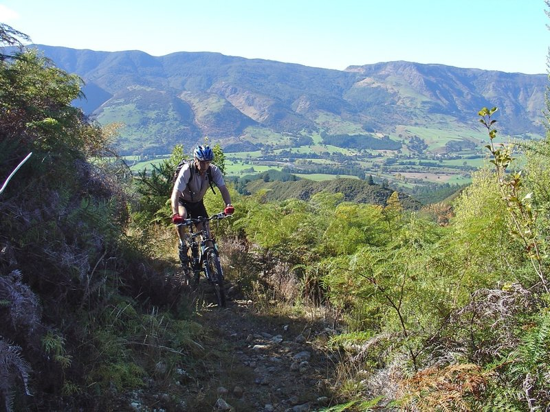 Gaining height above on Kill Devil Spur with views of the Takaka Valley opening up.