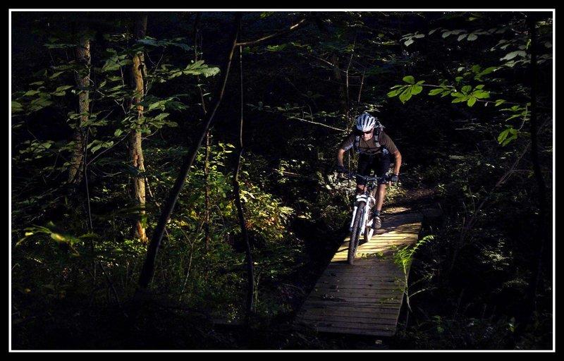 Crossing a bridge on the Frontier Loop Trail in Kris-Mar Woods.