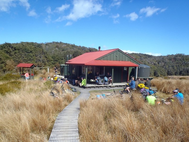 Trampers (what Kiwis call hikers) and mountainbikers stop for lunch at Saxon Hut.