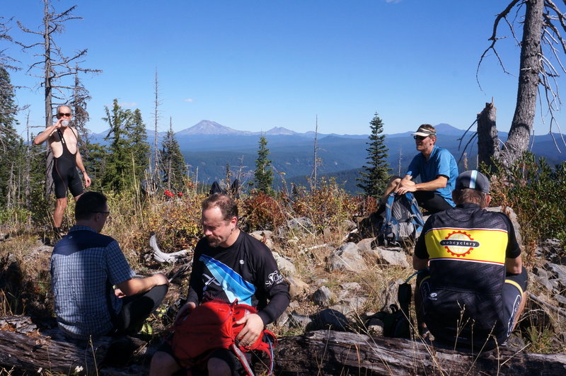 Grabbing some lunch after the climb with amazing views of the Three Sisters, Broken Top and Mt. Bachelor on the horizon.