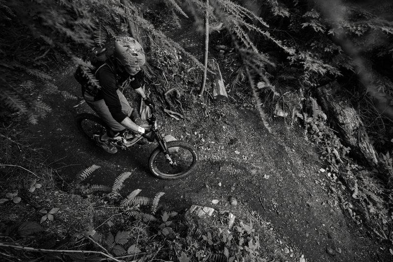 Michael Thompson berms through an abrupt chicane on lower Joy Ride.