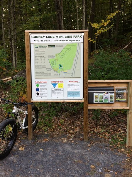 Trail map sign near entrance at Gurney. Brochures and trail maps of other local parks are also available here.