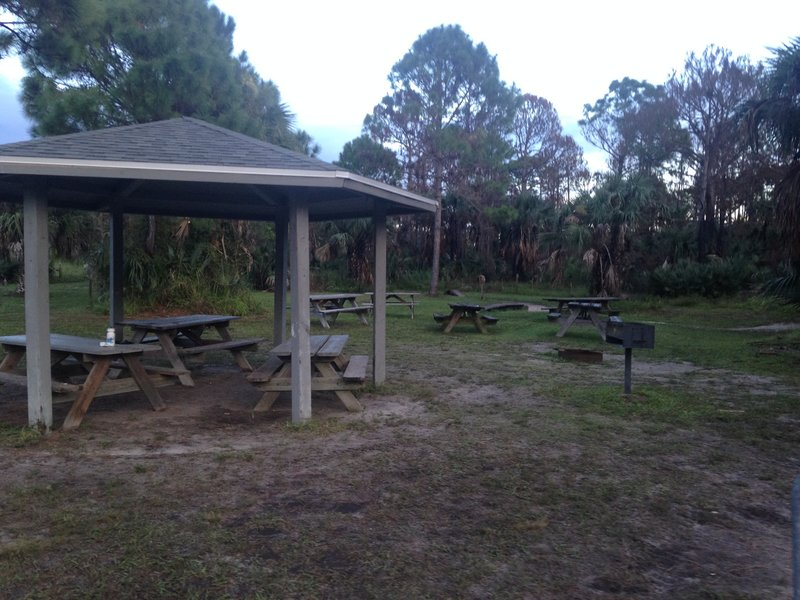 Picnic tables, baroque grill at the trailhead.