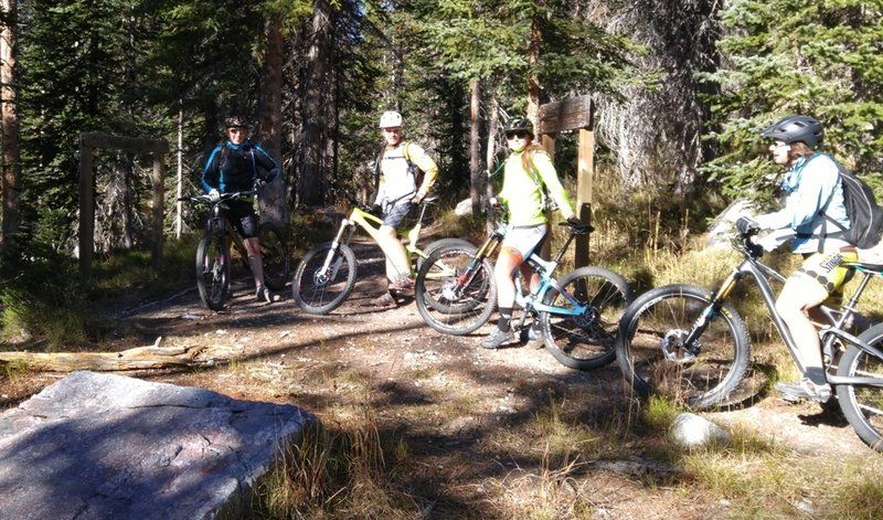 Riders pause at junction of Tipple Trail and French Creek Trail.