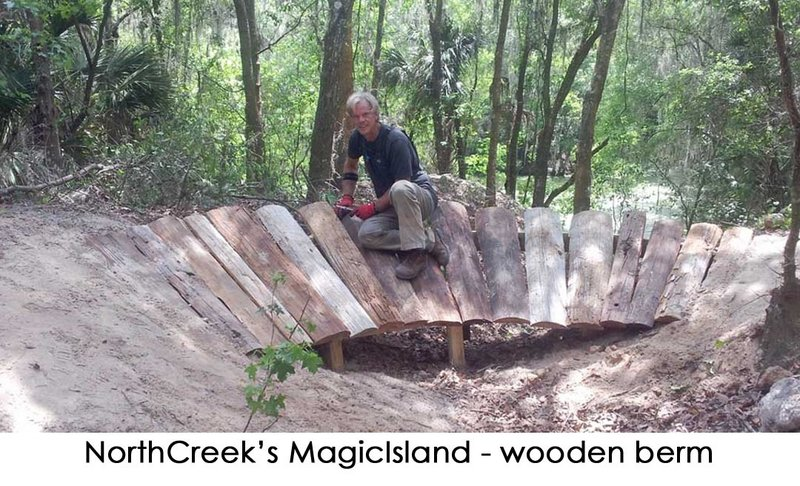 The trail crew, working hard to build berms on Magic Island.